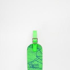Etiquette à bagage en cuir vert, Undercover, 16,99 euros