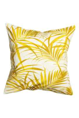 Housse de coussin en coton imprimé feuilles jaunes, H&M Home, 7,99 euros