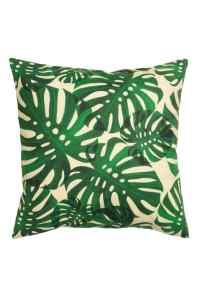 Housse de coussin à motif feuilles vertes, H&M Home, 7,99 euros