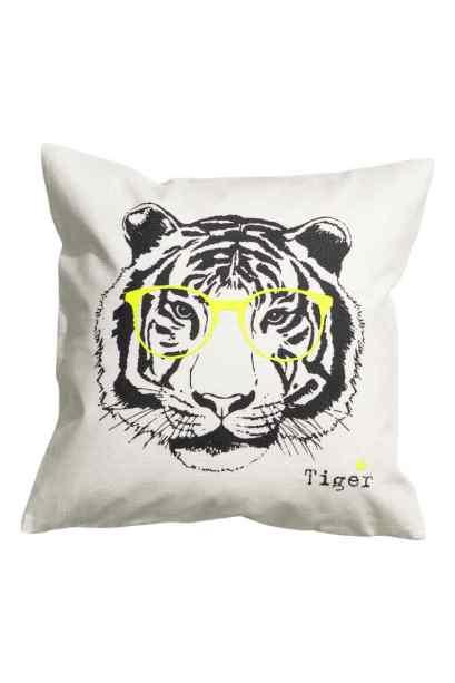 Housse de coussin à motif tigre, H&M Home, 4,99 euros