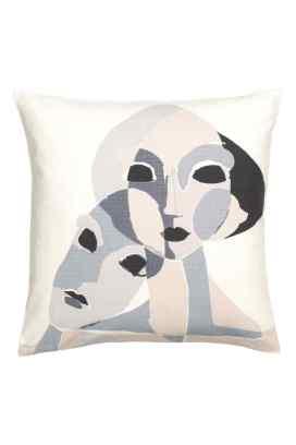 Housse de coussin en coton imprimé visages, H&M Home, 9,99 euros