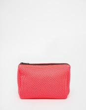 Trousse à maquillage en tulle fluo, Asos, 11,49 euros