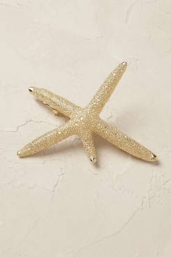 Barrette étoile de mer dorée, Anthropologie, 24 euros